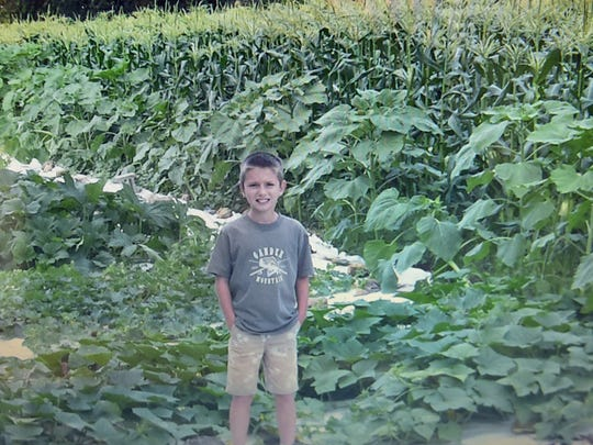 National Bonnie Plant Cabbage Program winner Corbin Kelly, 10, Shippensburg, stands in the garden where he grew his award winning cabbage.