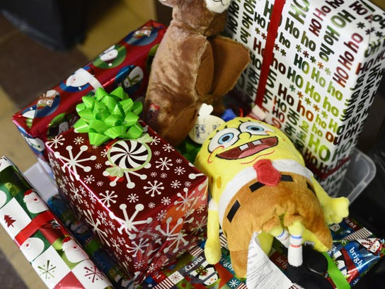 Recycling wrapping paper and reusing ribbons and bows are among the ways to promote sustainability during the holiday season.