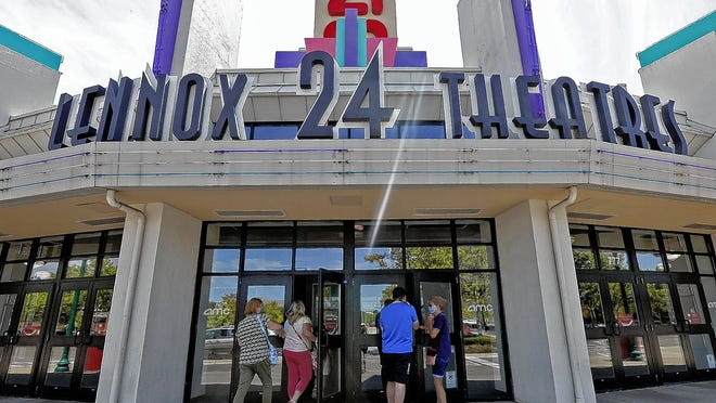 Moviegoers enter the AMC Lennox Town Center 24, 777 Kinnear Road in Columbus, when it reopened Aug. 20 for the first time since the early days of the COVID-19 coronavirus pandemic in March.