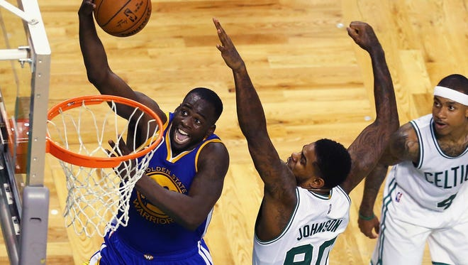 Draymond Green takes a shot against the Celtics' Amir Johnson.
