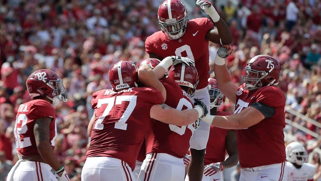 Alabama running back Bo Scarbrough celebrates after Alabama tight end Hale Hentges scores a touchdown against Fresno State last week. The Crimson Tide are a four-touchdown favorite over Colorado State on Saturday.