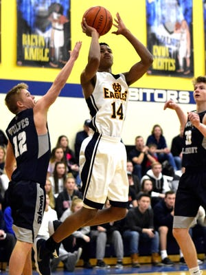 Kameron Gibson eyes the basket for a Walnut Hills score, Jan. 19, 2018.