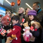 Refugees arrive in Canada on Dec. 28, 2015.