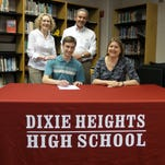 Dixie Heights High School senior Daniel John Kennedy has signed with University of Kentucky where he will major in mechanical engineering. He is a Kentucky Governor's Scholar and Eagle Scout. Kimberly, John, and Daniel Kennedy are shown with Dixie Heights Principal Karen Hendrix.