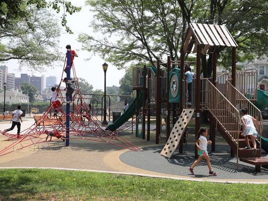 Children enjoy the brand new Lincoln Park playground