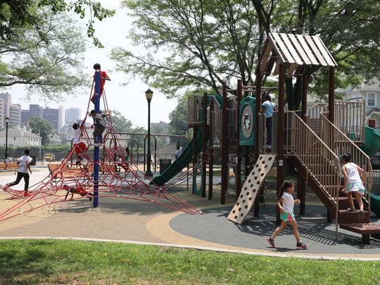 Children enjoy the brand new Lincoln Park playground on Lincoln Avenue in New Rochelle, July 3, 2018.