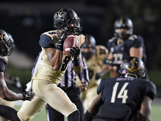 Wide receiver Ronald Monroe catches a pass during Vanderbilt's Black & Gold spring game Friday night at Vanderbilt Stadium.