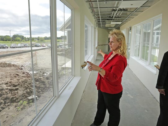 Joan Kleist, nursing home administrator for the Sheboygan Senior Community, explains the new facility during a tour Thursday August 20, 2015 in Sheboygan.