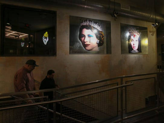 Artwork fit for The Queen hangs in the building's lobby,