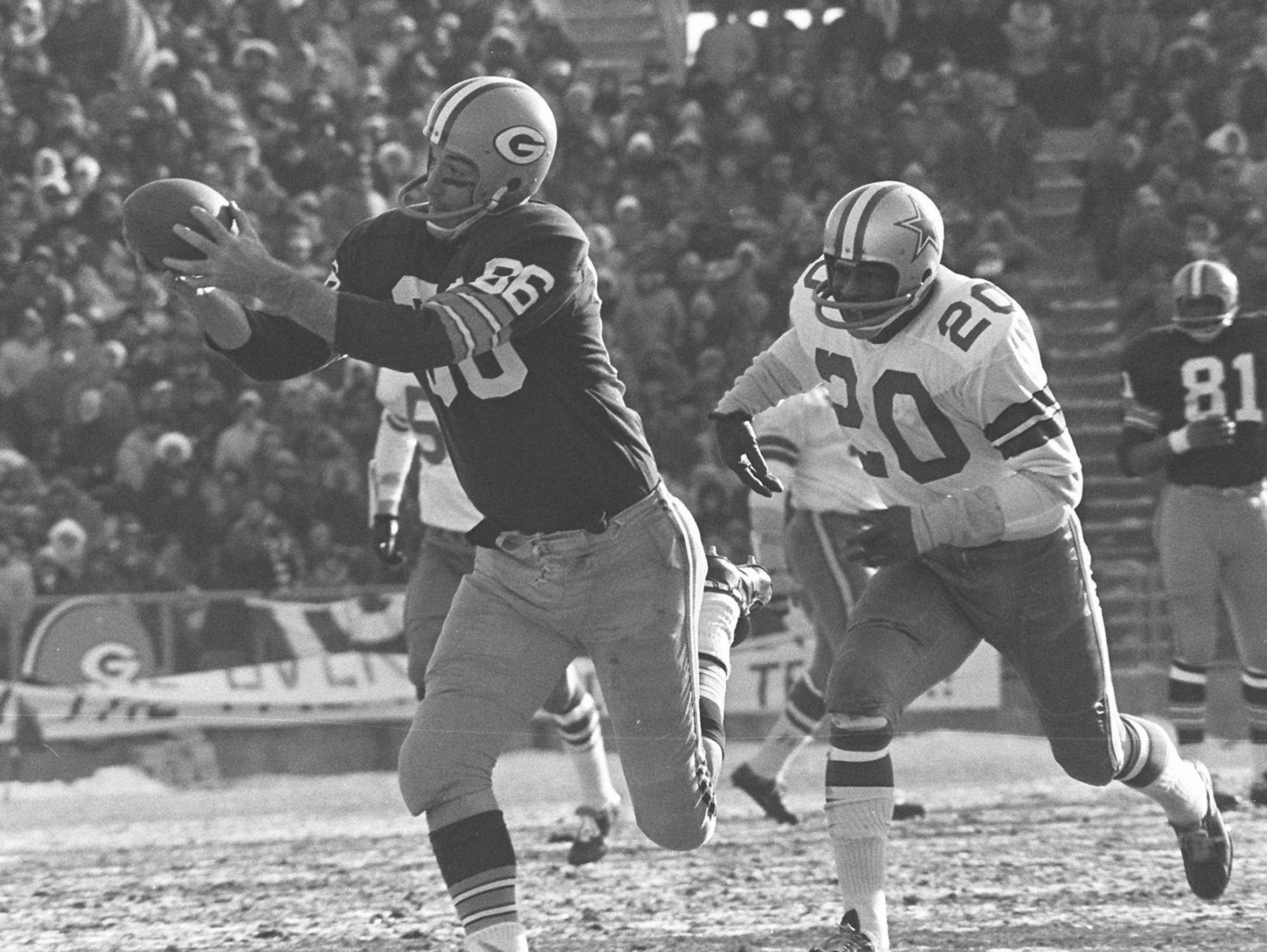 Boyd Dowler hauls in one of his two touchdown passes from Bart Starr that staked the Green Bay Packers to an early 14-0 lead against the Dallas Cowboys in the 1967 NFL Championship Game on Dec. 31, 1967 at Lambeau Field.