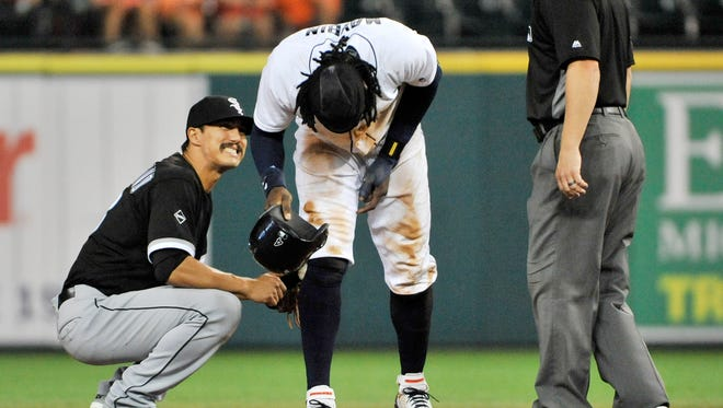 Tigers' Cameron Maybin in pain after re-injuring his thumb sliding into second base in the fifth inning Monday. At left is Chicago's Tyler Saladino.