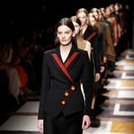 Models wear creations for Salvatore Ferragamo women's Fall-Winter 2015-2016 collection, part of the Milan Fashion Week, unveiled in Milan, Italy, Sunday, March 1, 2015.
