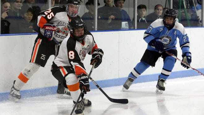 Mamaroneck's Connor Le Blanc moves the puck in front of teammate Michael Carducci and Suffern's Shaan Greenberg during their hockey game at the Hommocks Ice Rink in Larchmont, Jan. 6, 2017.