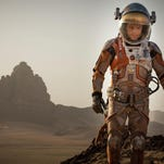 """This photo released by 20th Century Fox shows Matt Damon in a scene from the film, """"The Martian."""" A variety of Damon's films will be on various cable channels Tuesday night."""
