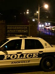 More than a dozen Knoxville Police Department cruisers surrounded Ridgebrook Apartments on Thursday night as a negotiator using a megaphone spoke to at least one person inside one of the apartments.