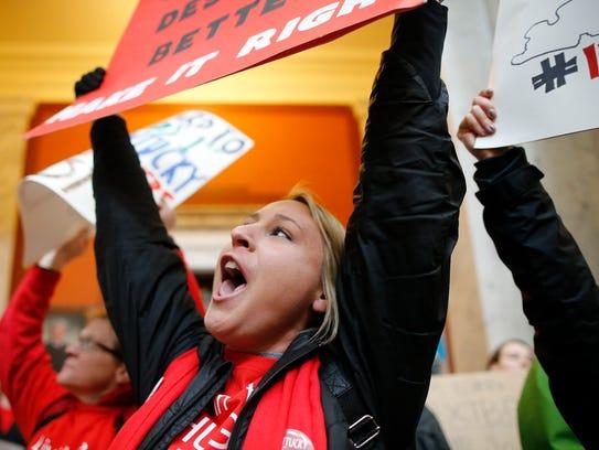 Courtney Sorrell, a Holmes Middle School teacher, chants