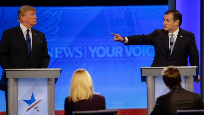Republican presidential candidate, Sen. Ted Cruz, R-Texas, points at Republican presidential candidate, businessman Donald Trump during a Republican presidential primary debate hosted by ABC News at the St. Anselm College  Saturday, Feb. 6, 2016, in Manchester, N.H.
