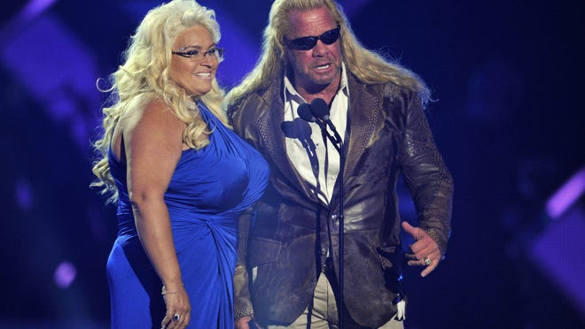 "In this June 5, 2013, photo, Duane ""Dog"" Chapman, right, and Beth Chapman present the award for CMT performance of the year at the CMT Music Awards at Bridgestone Arena in Nashville, Tenn. Chapman, the wife and co-star of ""Dog the Bounty Hunter"" reality TV star Duane ""Dog"" Chapman, died on June 26, 2019."