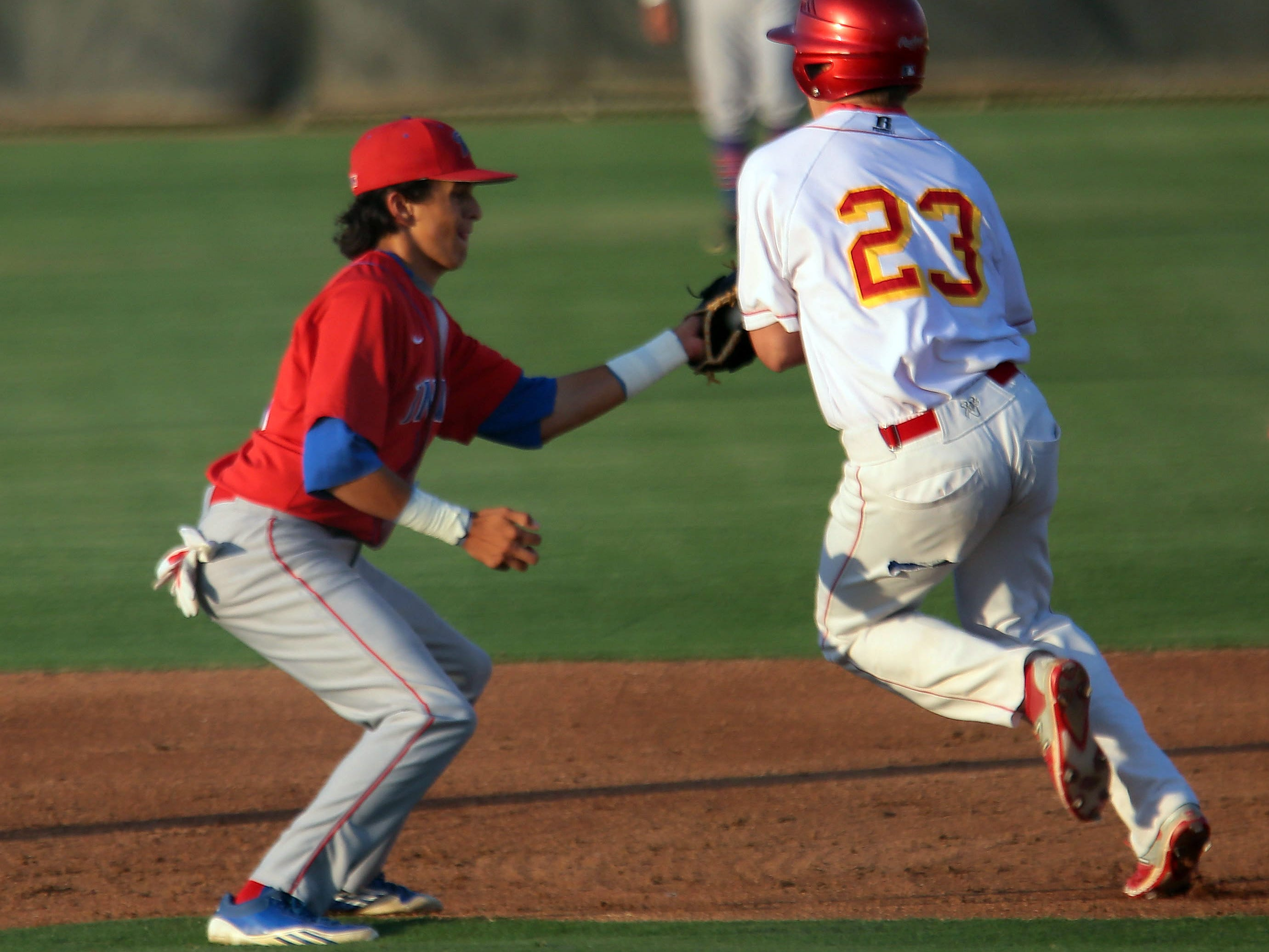 Indio's Michael Munoz tags out Palm Desert's Beau Berryhill trying to reach 2nd in the first inning on Tuesday in Palm Desert.