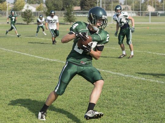 El Diamante senior Mason Garispe catches a pass during