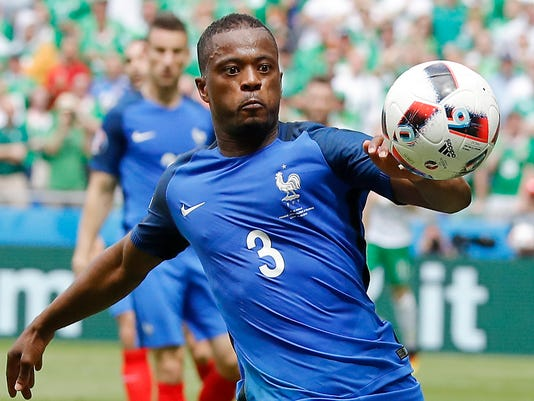 FILE - This is a Sunday, June 26, 2016 file photo of France's Patrice Evra as he eyes the ball during the Euro 2016 round of 16 soccer match between France and Ireland, at the Grand Stade in Decines-­Charpieu, near Lyon, France. Former France defender Patrice Evra Wednesday Feb. 7, 2018  signed for West Ham on a short-term deal, three months after getting fired by Marseille and banned from UEFA competitions for kicking a fan before a Europa League match. The 36-year-old left back returns to the Premier League after ending a trophy-laden, eight-year spell at Manchester United in 2014. (AP Photo/Laurent Cipriani/File)