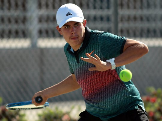 Indio's Eleazer Vazquez plays against Quinn Bush of Palm Desert High School as the Aztecs and Rajahs face off in a boys varsity tennis match on Tuesday, April 7, 2015 at Indio High School.
