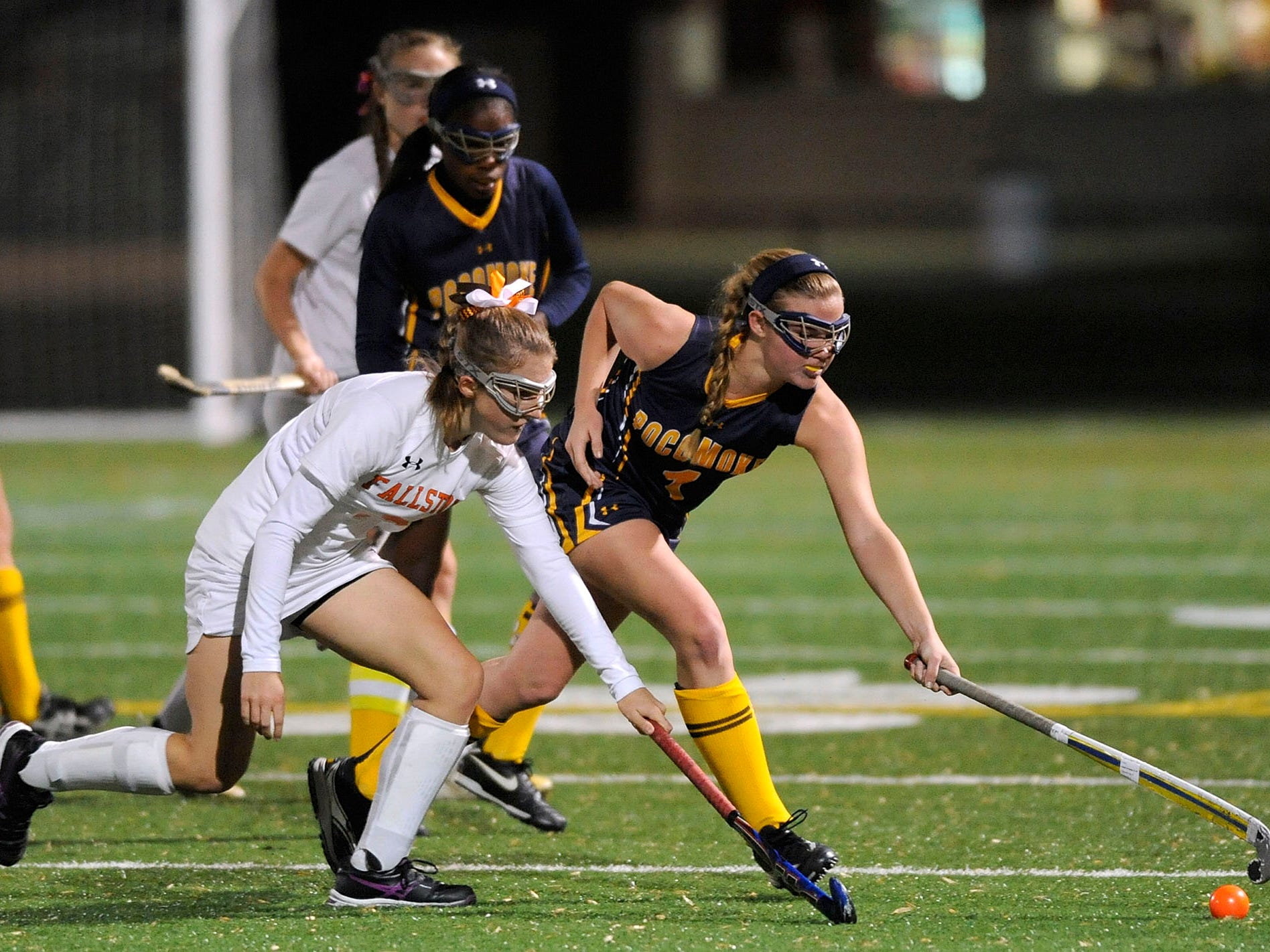 Pocomoke's McKenzie Beauchamp, right, battles Fallston's Kyle Ryan for a ball in the second half of a state semifinal field hockey game Monday, Nov. 3, 2014 in Annapolis. (Photo by Steve Ruark for The Daily Times)
