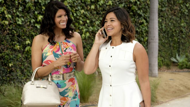 Andrea Navedo as Xo and Gina Rodriguez as Jane in CW's 'Jane the Virgin.'