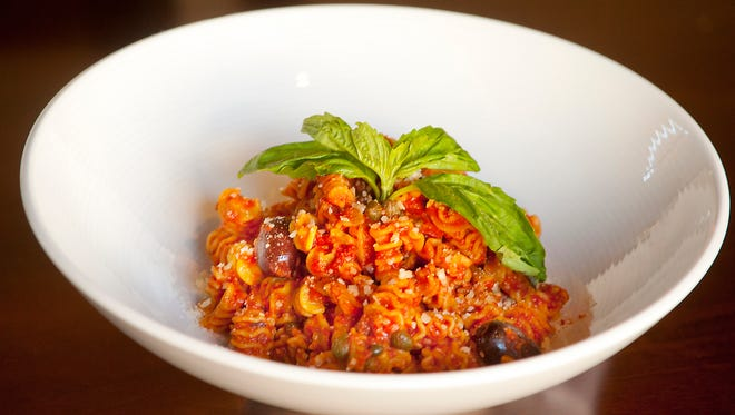 Sarino chef Carmelo Gabriele's traditional pasta puttanesca made with Kalamata olives, capers, anchovies and San Marzano tomatoes imported from Italy, topped with springs of basil. The chef says the dish is just right for those who prefer a little salt in their sauce. Dec. 27, 2017
