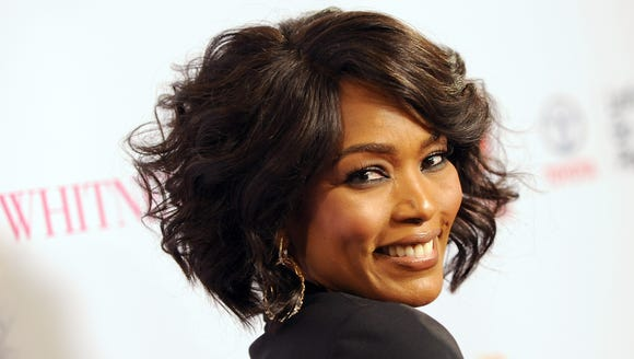 """Director Angela Bassett is all smiles at Whitney"""" premiere."""