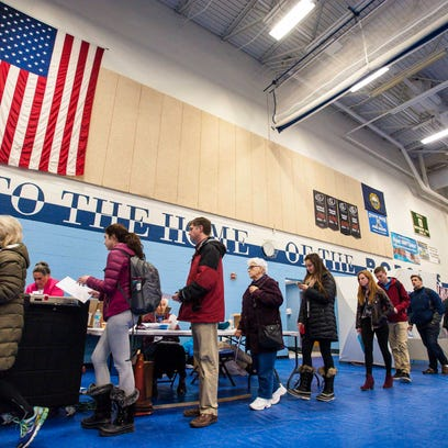 Voters line up to submit their ballots at Oyster River