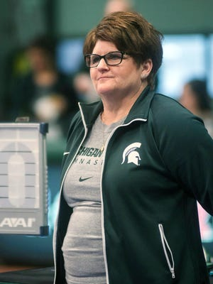Michigan State gymnastics coach Kathie Klages watches the team during a meet in East Lansing on Feb. 13, 2015.