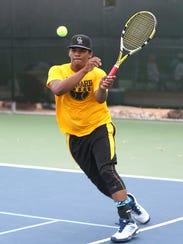 Menard's Kolby Hernandez hits the ball back to Garden
