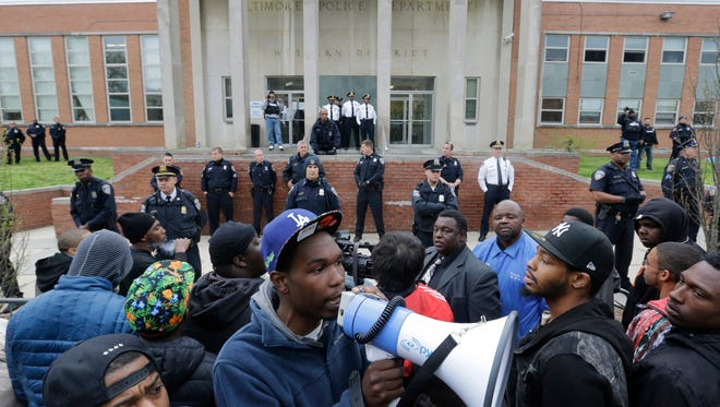 Protesters for Freddie Gray stand outside the Baltimore Police Department's Western District police station, Thursday, April 23, 2015, in Baltimore. Gray died from spinal injuries about a week after he was arrested and transported in a police van. (AP Photo/Patrick Semansky)