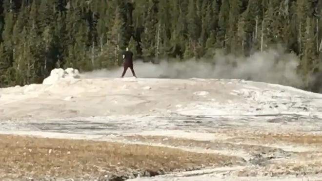 Tourists visiting Old Faithful in Yellowstone National Park yelled at an adult man who reportedly walked over to the geyser and stepped on top of it.