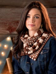 The Delancy Cowl pairs stripes with bold, open circles to create a unique doubled-over cowl.