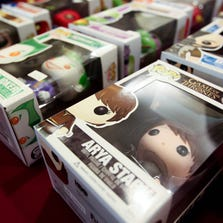 Toys from a variety of movies, comics and TV shows sit on display at the Pop Culture Paradise booth during CopperCon: Revolution at the Windemere Hotel and Conference Center, August 8, 2013 in Mesa.
