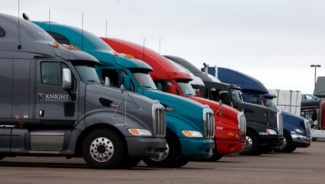 Big rigs stack up at the Flying J Truck Stop along Interstate 70 near the small Colorado plains community of Limon in this 2009 file photo