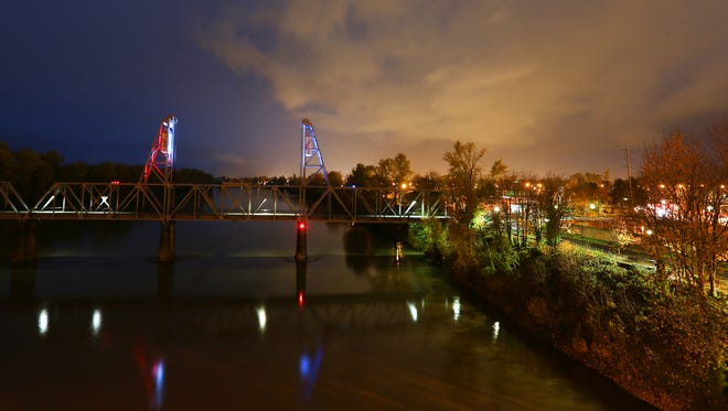 The City of Salem lit the Union Street pedestrian bridge the colors of the French flag, Wednesday, November 18, 2015, in Salem, Ore. The bridge was lit in a tribute to those killed and injured in last week's Paris attacks