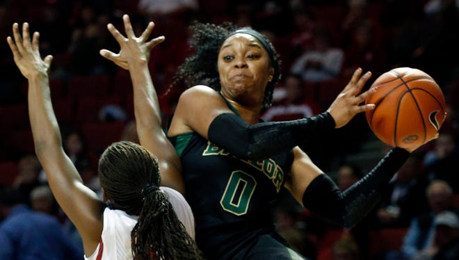Baylor's Odyssey Sims throws a ball past Oklahoma's Sharane Campbell during the first half in Norman, Okla.