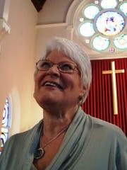 Darlene Ehrlich rehearses for the Singing Ambassadors'