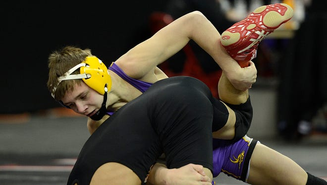 Denmark's Brock Bergelin battles Grafton's Arturo Duran in a 106-pound WIAA Division 2 state semifinal match last season at the Kohl Center in Madison. Bergelin is the area's only returning state champion this season.