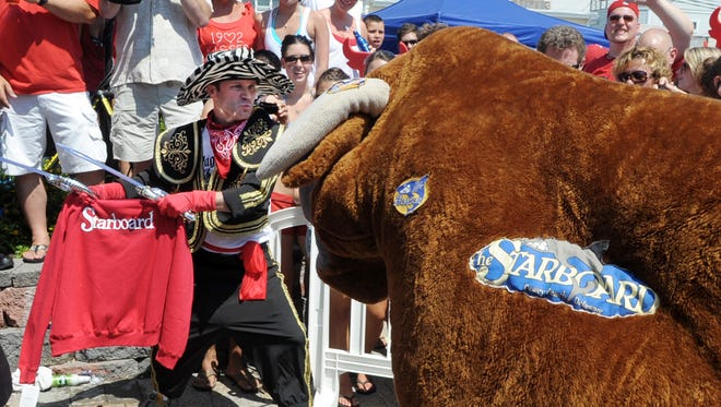 A matador squares off with the bull, at Dewey Beach's annual July event.
