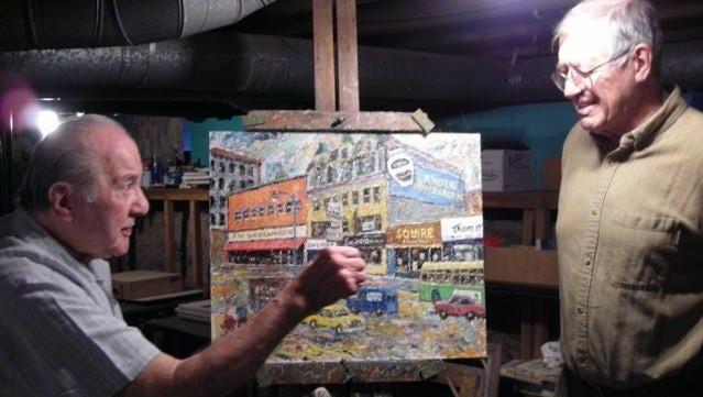 David Rossie, right, visits artist Armondo Dellasanta in his studio in December 2008.
