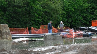 Crews standby a construction site of sewage pipe repair project where some raw sewage leaked out during to flooding for the Harpeth River this weekend.  The repair was days away from being complete near a greenway trail at Chestnut Bend subdivision.