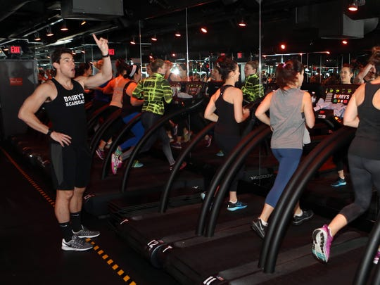 Instructor Matt Nolan leads a Barry's Bootcamp class, an hour-long interval cardio and strength workout, Jan 25. 2017 in Scarsdale.