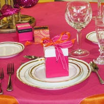 This setting salutes Betsey Johnson with a raspberry and tangerine table.
