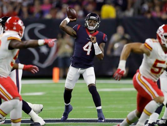 Houston Texans quarterback Deshaun Watson (4) throws against the Kansas City Chiefs during the first half of an NFL football game Sunday, Oct. 8, 2017, in Houston. (AP Photo/David J. Phillip)