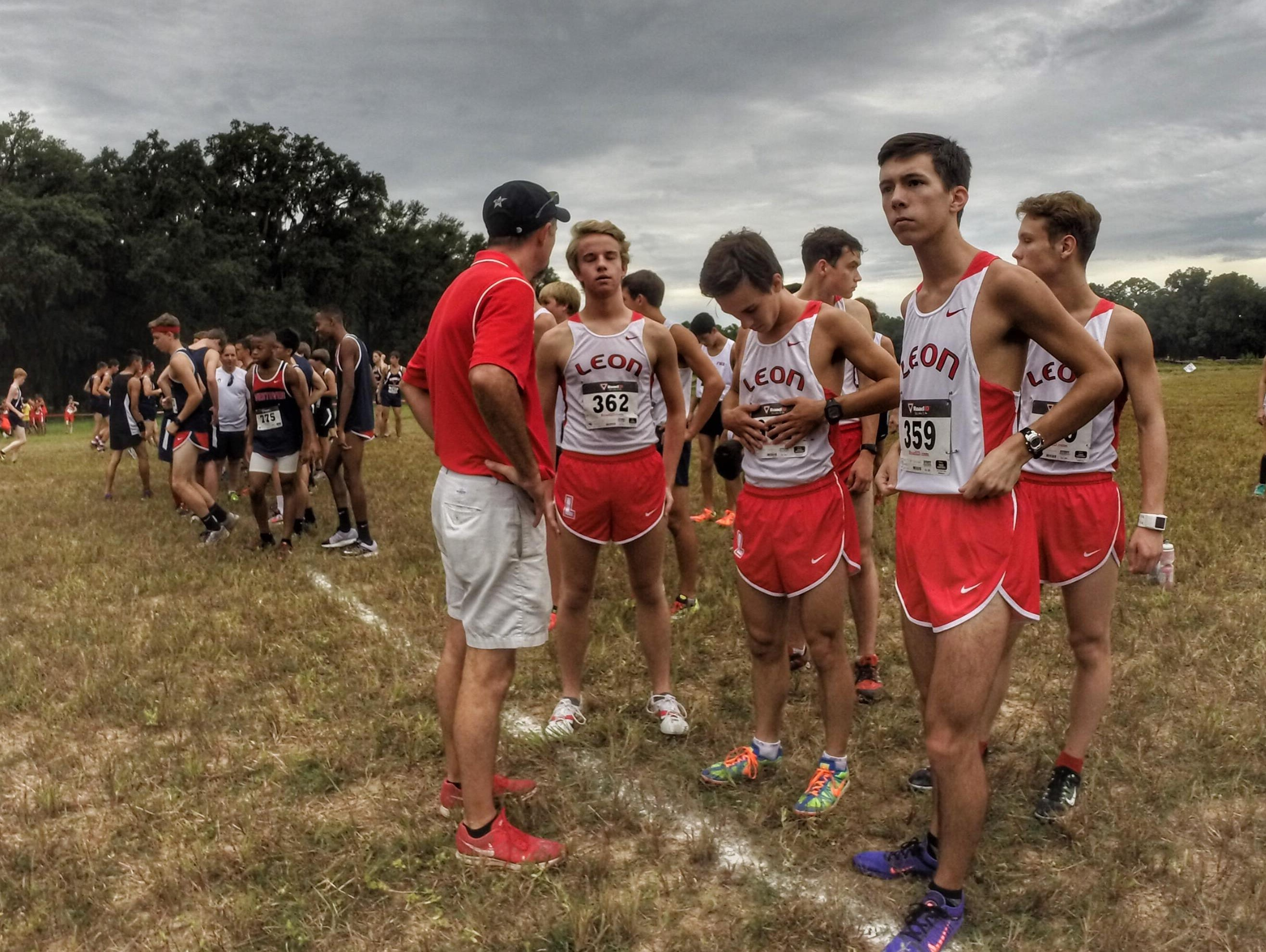 Leon coach Andrew Wills talks to his mostly new cross country team prior to last Saturday's Cougar XC Challenge at Elinor Klapp-Phipps Park.
