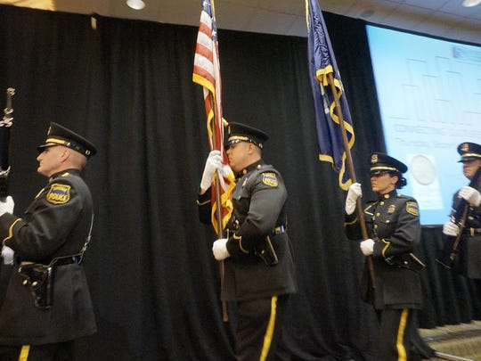 Livonia Police Department Color Guard posts the flag at Livonia's State of the City event Wednesday.
